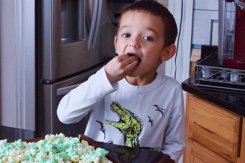 A Eating St. Patrick's Day Popcorn
