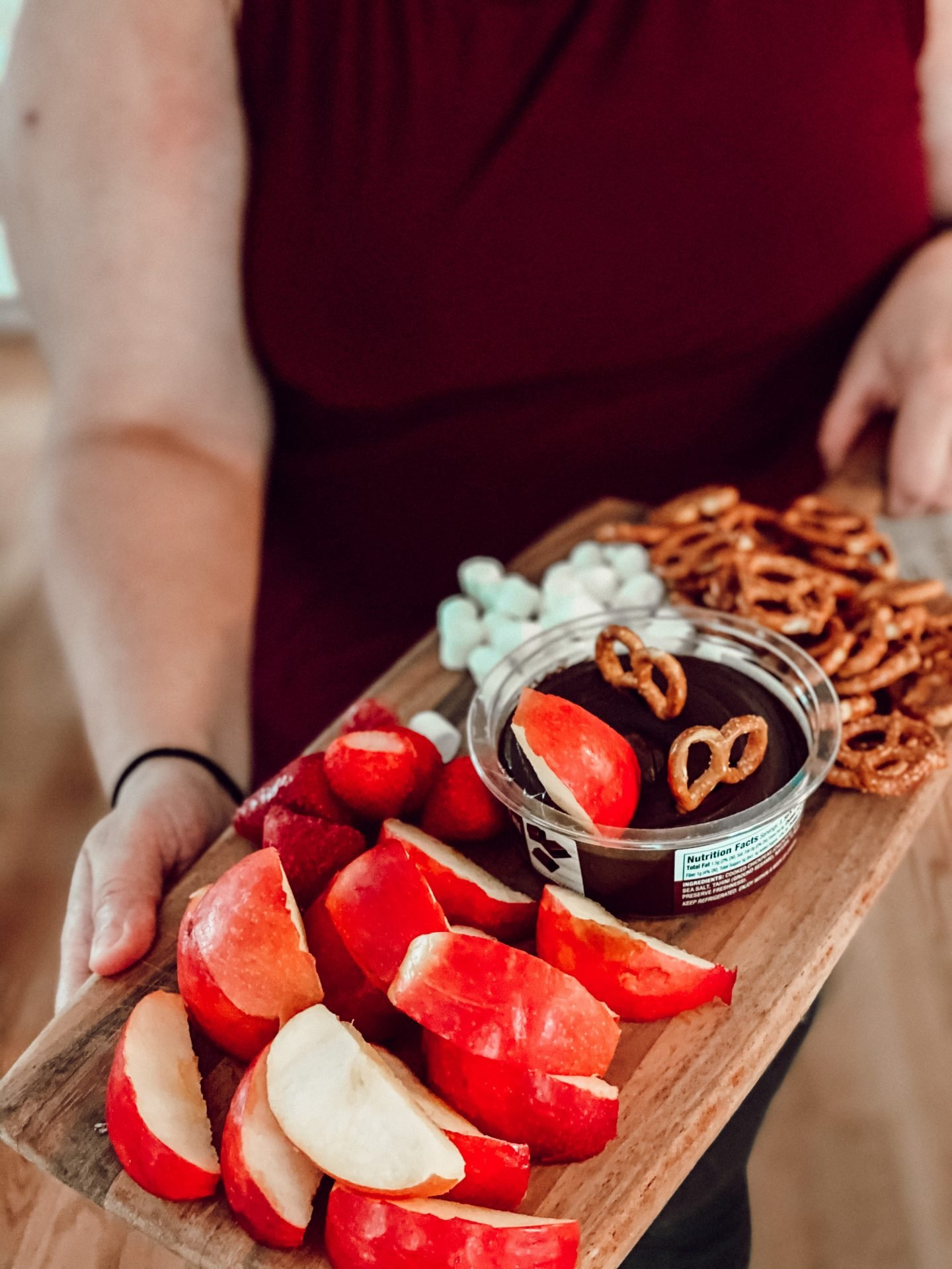Fruit and sweets snack board with Tribe Hummus | #ad #TribeVDayTreats #tribehummus #valentinesdaysnack
